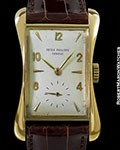 "PATEK PHILIPPE 2442 ""BANANA"" VINTAGE 18K FLARED CASE"