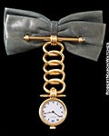 PATEK PHILIPPE 4762J BOW TIE BROOCH PENDANT WATCH 18K YG
