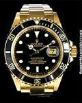 ROLEX SUBMARINER 16618 18K BLACK DIAL NEW BOX PAPERS